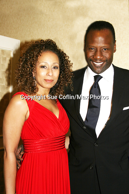 Husband Gregory Generet poses with Tamara Tunie - ATWT & Law & Order SVU is presented the Linda Dano Heart Award by Linda Dano at the HeartShare 2010 Spring Gala and Auction on March 25, 2010 at the New York Marriott Marquis, New York City, New York. (Photo by Sue Coflin/Max Photos)