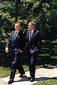 United States President George H.W. Bush walks on the White House grounds in Washington, DC with Prime Minister Brian Mulroney of Canada on May 4, 1989.<br /> Mandatory Credit: David Valdez / White House via CNP