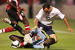 10 September 2008: Landon Donovan (USA) (10) collides with Trinidad and Tobago goalkeeper Marvin Phillip (TRI) (below). The United States Men's National Team defeated the Trinidad and Tobago Men's National Team 3-0 at Toyota Park in Bridgeview, Illinois in a CONCACAF semifinal round FIFA 2010 South Africa World Cup Qualifier.