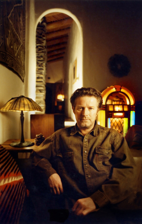 Grammy Award winning singer and drummer Don Henley in his Hollywood Hills spanish style home. He was formerly with the great band The Eagles. Mr. Henley was extremely patient waiting for the photogapher when the unusually heavy rain in the southland delayed travel by a couple hours over the 30 mile drive from Orange County. Mr. Henley sat here to speak with Mendenhall. As a custom, Mendenhall noted how he was postured and had him stay there while he added a strobe light in the hallway to repeat the arc patterns in addition to the main light from a soft box and strobe.