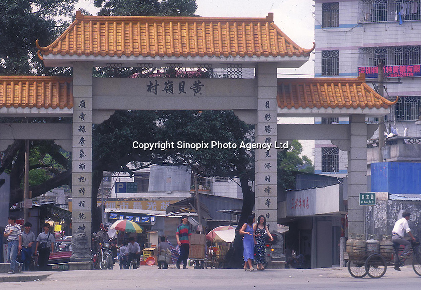 "Village gates of Huang Beiling, also known as ""Second Wife Village"" in Shenzhen, China.  The ""village"" is famous for the number of second wives  living there that cater either to wealthy local men or Hong Kong men that live just across the border and visit on weekends...PHOTO BY SINOPIX"