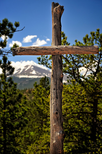 Wooden cross with Meeker Peak in the background above Highlands Presbyterian Camp in Allenspark, Colorado