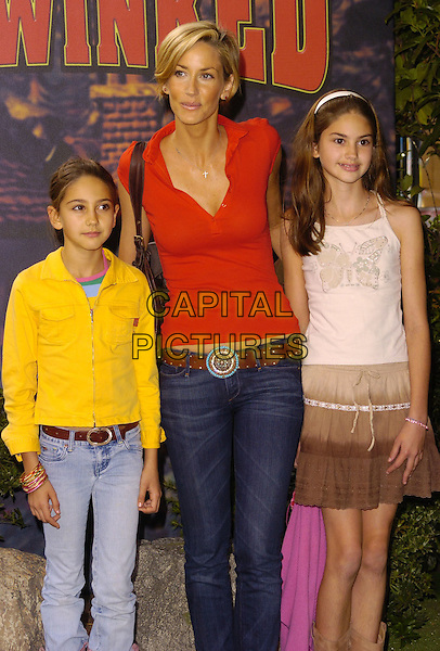 "LISA BUTCHER & DAUGHTERS.At the UK Film Premiere of ""Hoodwinked"",.Vue West End Cinema, London, England,.September 24th 2006..half 3/4 length red top jeans mother mum family kids children.Ref: CAN.www.capitalpictures.com.sales@capitalpictures.com.©Can Nguyen/Capital Pictures"