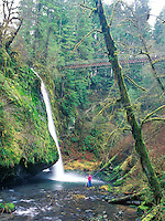Drift Creek Falls Bridge with two people. Oregon.