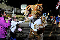NWA Media/ J.T. Wampler -Children greet Rudolph the Red Nosed Reindeer Monday Dec. 1, 2014 during the Rogers Christmas parade sponsored by Main Street Rogers. Rockin' Around the Christmas tree was this year's theme. Around 100 entries participated in the parade.