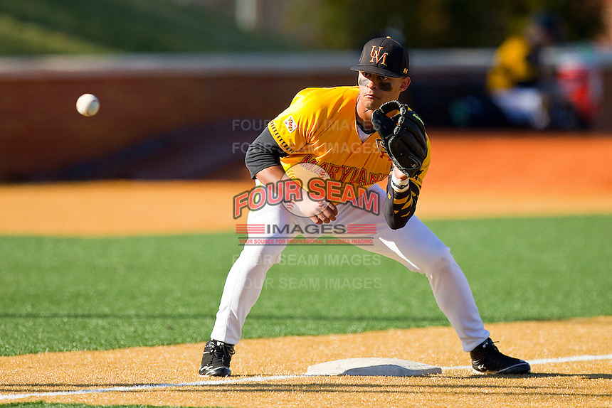 Maryland Terrapins third baseman K.J. Hockaday #8 waits for a throw during infoeld practice prior to the game against the Wake Forest Demon Deacons at Wake Forest Baseball Park on March 10, 2012 in Winston-Salem, North Carolina.  (Brian Westerholt/Sports On Film)