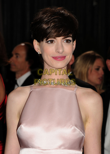Anne Hathaway (wearing Prada).85th Annual Academy Awards held at the Dolby Theatre at Hollywood & Highland Center, Hollywood, California, USA..February 24th, 2013.oscars half length pink sleeveless silk satin  jewel encrusted embellished dress.CAP/ROT/TM.©Tony Michaels/Roth Stock/Capital Pictures