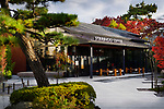 Starbucks Coffee, American fast food restaurant chain coffeehouse in colorful autumn scenery. Uji, Kyoto Prefecture, Japan 2017