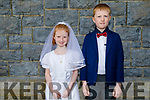 Nora O'Carroll who received her First Holy Communion in KIlmoyley on Saturday standing with her brother Des O'Carroll.