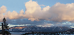 """South Lake Tahoe""  panoramic of Lake Tahoe, Heavenly Ski Resort and Freel Peak(Tahoe's tallest peak). I captured this image during the month of January 2013.  The clouds were enormous and kept changing every 10 minutes.  This panoramic has Heavenly and Freel Peak with Lake Tahoe."