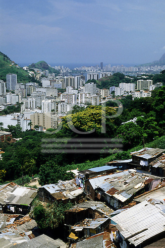 Rio de Janeiro, Brazil. Favela (shanty town) Dona Marta; contrast with high-rise apartment and office buildings below.
