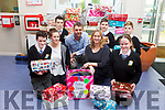 Students from Colaiste na Riochta in Listowel donated shoeboxes to homeless on Friday morning. Pictured were: Donal Kelly, Mollie Burke (teacher), Dylan Lynch, Ronan Doherty (Arlington Lodge), Iseult Glynn (Deputy Principal), Darragh Mulvihill, Aaron Broderick and Néidin Moloney.