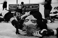 """Roadhouse Rhonda"" of the Oakland Outlaws stretches before the Bay Area Derby Girls' season opener in Oakland, CA...(©Matt McKnight, 2008)"