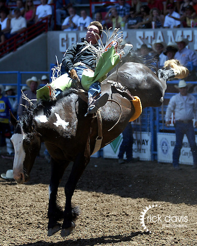 Greeley, Colorado cowboy Royce Ford scored an 85 point bareback ride on the Buetler & Son bronc No Date Kate in front of his hometown fans at the July 29th performance of the Greeley Independence Stampede in Greeley, Colorado.