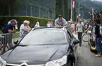 (Team Tinkoff owner) Oleg Tinkov jumps on the back bumper of a passing car at the start for a little 'ride-along'<br /> <br /> Stage 19:  Albertville &rsaquo; Saint-Gervais /Mont Blanc (146km)<br /> 103rd Tour de France 2016