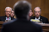 UNITED STATES - SEPTEMBER 27: Chairman Charles Grassley, R-Iowa, and Sen. Orrin Hatch, R-Utah, listen to Judge Brett Kavanaugh during the Senate Judiciary Committee hearing on his nomination be an associate justice of the Supreme Court of the United States, focusing on allegations of sexual assault by Kavanaugh against Christine Blasey Ford in the early 1980s. (Photo By Tom Williams/CQ Roll Call)