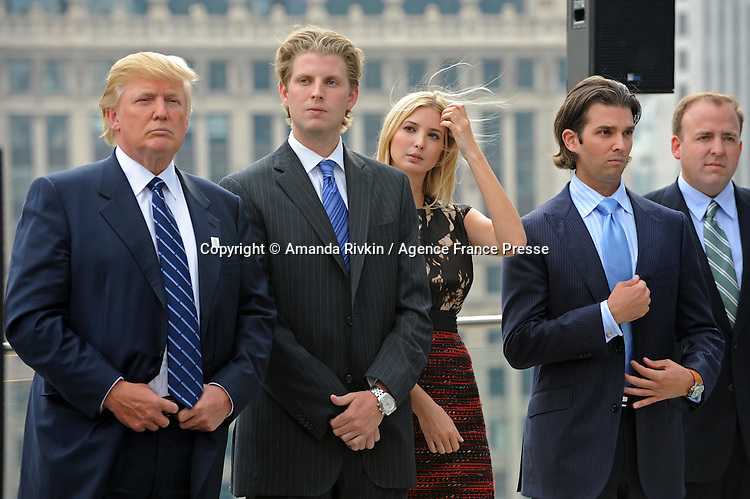 (L-r) Donald Trump, Eric Trump, Ivanka Trump, Donald Trump Jr. and Chicago Alderman Brendan Reilly appear at the topping-off ceremony of the new 92-story tall Trump International Hotel and Tower building in Chicago, Illinois on September 24, 2008.  The building will be the tallest in North America upon its completion in six months.