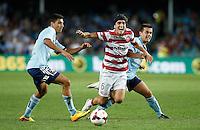 Wanderers Jerome Polenz (C) is fouled by Sydney FC Hagi Gligor (R) during their A-League match in Sydney, March 8, 2014. VIEWPRESS/Daniel Munoz EDITORIAL USE ONLY