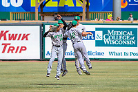 Clinton LumberKings outfielder Dimas Ojeda (14), outfielder Billy Cooke (2), outfielder Jack Larsen (3) and second baseman Louis Boyd (12) celebrate a win during a Midwest League game against the Wisconsin Timber Rattlers on April 26, 2018 at Fox Cities Stadium in Appleton, Wisconsin. Clinton defeated Wisconsin 7-3. (Brad Krause/Four Seam Images)