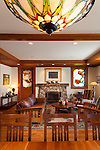Large stone fireplace with wood mantle and stained glass windows are among the unique elements in this Craftsman style home. This image is available through an alternate architectural stock image agency, Collinstock located here: http://www.collinstock.com