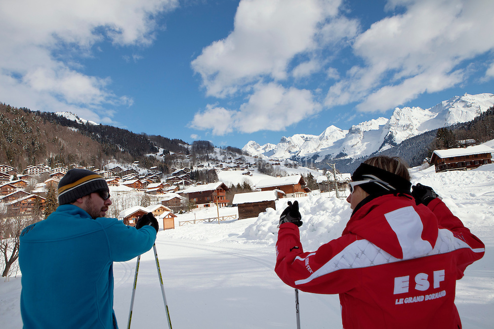 Mylene, a cross country ski instructor (red jacket), gives Marguet (blue jacket) his first lesson on the cross country ski trail at Le Grand Bornand, France, 14 February 2012.