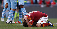 Calcio, finale di Coppa Italia: Roma vs Lazio. Roma, stadio Olimpico, 26 maggio 2013..AS Roma forward Mattia Destro reacts as Lazio players celebrate at the end of the Italian Cup football final match between AS Roma and Lazio at Rome's Olympic stadium, 26 May 2013. Lazio won 1-0..UPDATE IMAGES PRESS/Isabella Bonotto....