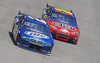 Jun 1, 2008; Dover, DE, USA; NASCAR Sprint Cup Series driver Kurt Busch (2) leads Jeff Gordon (24) during the Best Buy 400 at the Dover International Speedway. Mandatory Credit: Mark J. Rebilas-US PRESSWIRE