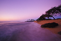 Sunset with softly blurred waves at Haleiwa Alii Beach Park, North Shore, Oahu, Hawaii