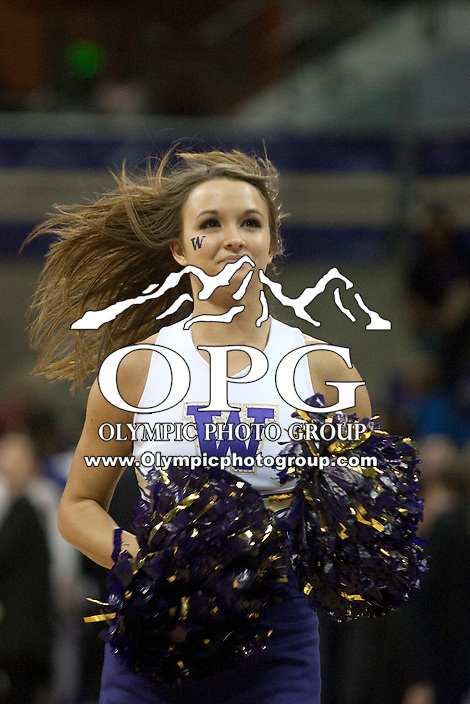 Dec 29, 2011:  Washington cheerleader Courtney Dill entertained fans during a timeout against Oregon State.  Washington defeated Oregon State 95-80 at Alaska Airlines Arena Seattle, Washington...