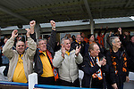 Wealdstone 0 Newport County 0, 17/03/2012. St Georges Stadium, FA Trophy Semi Final. Visiting supporters celebrating at the final whistle at St Georges Stadium, home ground of Wealdstone FC, as the club played host to Newport County (yellow) in the semi-final second leg of the F.A. Trophy. The game ended in a goalless draw, watched by a capacity crowd of 2,092 which meant the visitors from Wales progressed by three goals to one to the competition's final at Wembley, where they would meet York City. The F.A. Trophy was the premier cup competition for non-League clubs in England and Wales affiliated to the Football Association. Photo by Colin McPherson.