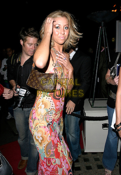 "GRACE ADAMS-SHORT.At Loaded Magazine's ""Britain's Sexiest Singles"" Party, The Play Room, Air Street, London,.England, August 1st 2006..half length adams short long sheer see through dress red patterned print louis vuitton bag hand touching head hair.Ref: AH.www.capitalpictures.com.sales@capitalpictures.com.©Adam Houghton/Capital Pictures."