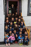 Blind Tibetan headmaster Nyima Wangdu (Centre, top) poses with his blind and visually impaired Tibetan students at the School for the Blind in Tibet, in the capital city of Lhasa, September 2016.