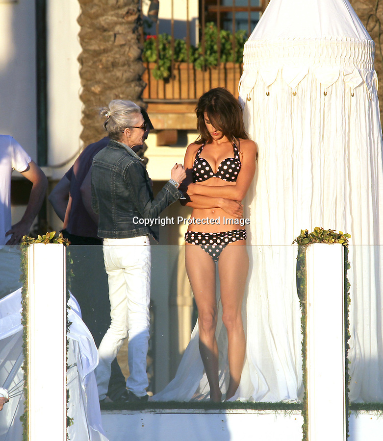 Exclusive February 10th 2011..Photo shoot for Victoria's Secret wearing bikini's & lingerie on the beach in Malibu California. .Alessandra Ambrosio wearing a black polka dot bikini a hot pink bra with lace panties underwear. Alessandra pushed her breasts together & modeled in a sea through nighty showing off her butt. She had massive amounts of hair spray & makeup on while shooting. A photographer got burned on the set by the sun so he rapped his face up with a towel. He looked like a ninja. It was pretty funny ...AbilityFilms@yahoo.com.805-427-3519.www.AbilityFilms.com