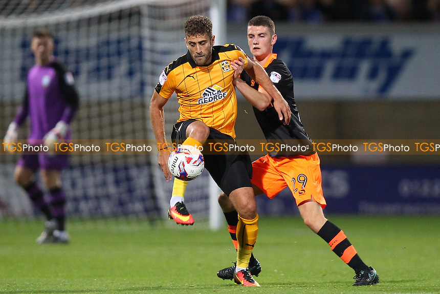 Ben Williamson of Cambridge United and Connor O'Grady of Sheffield Wednesday during Cambridge United vs Sheffield Wednesday, EFL Cup Football at the Abbey Stadium on 9th August 2016