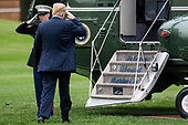 United States President Donald (R) salutes as he boards Marine One on the South Lawn of The White House on May 5, 2018 in Washington, DC. President Trump will travel to Cleveland, Ohio to speak at Public Hall ahead of state primary elections. <br /> Credit: Zach Gibson / Pool via CNP