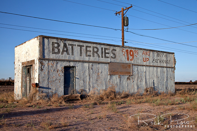 A weathered building alongside Route 66 in Holbrook, Arizona.