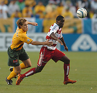 Chris Albright, left, Eddie Johnson, right, L.A. Galaxy vs FC Dallas, L.A. won 2-0.