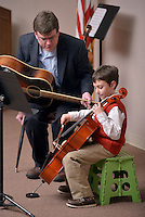 STAFF PHOTO BEN GOFF  @NWABenGoff -- 12/13/14 Bennett Hudson, 7, performs on the cello with accompaniment from instructor Will Bush during the Will Bush Violin Studio holiday recital at the Shiloh Museum of Ozark History in Springdale on Saturday Dec. 13, 2014.
