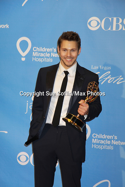 The Bold and The Beauriful - Scott Clifton wins the Emmy for Younger actor at the 38th Annual Daytime Entertainment Emmy Awards 2011 held on June 19, 2011 at the Las Vegas Hilton, Las Vegas, Nevada. (Photo by Sue Coflin/Max Photos)