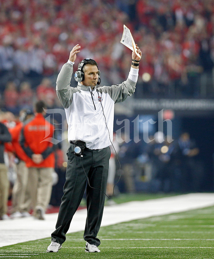 Ohio State Buckeyes head coach Urban Meyer puts up the stadium against Oregon Ducks during the 1st quarter in College Football Playoff Championship game at AT&T Stadium in Arlington, Texas on January 12, 2015.  (Dispatch photo by Kyle Robertson)