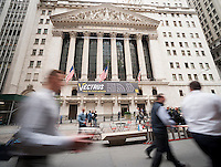 The front of the New York Stock Exchange is decorated for Vectrus on Monday, October 13, 2014 celebrating its recently listing on the NYSE. The Colorado Springs, CO based company supplies support services and management to U.S. government customers worldwide. (© Richard B. Levine)