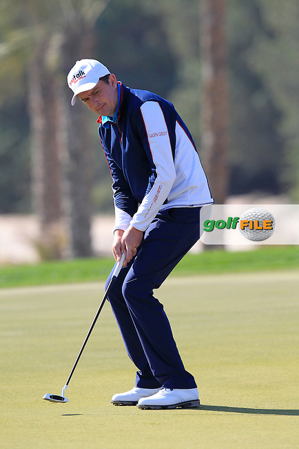 Peter LAWRIE (IRL) putts on the 10th green during Wednesday's Round 1 of the 2015 Commercial Bank Qatar Masters held at Doha Golf Club, Doha, Qatar.: Picture Eoin Clarke, www.golffile.ie: 1/21/2015