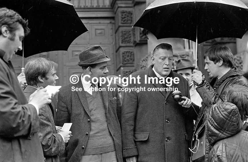Rev Ian Paisley being interviewed outside Crumlin Road Jail, Belfast, N Ireland, UK, on his release from prison following a government amnesty for anyone convicted of or still to be charged with a civil disorder offence that had occurred since October 1968. Also in the photograph is Major Ronald Bunting who was released at the same time. 196905060172f, 172/69.<br />