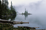 Sunrise Mowich lake in fog Cascade Mountain Range Mount Rainier National Park Washington State USA