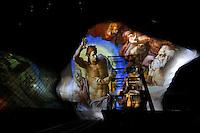 Proiezioni di luce su La Nuvola con gli affreschi di Michelangelo della Cappella Sistina<br /> Frescos by Michelangelo were projected on The Cloud<br /> Roma 19-07-2016 Apertura in anteprima per la stampa del 'La Nuvola' ideata dall'architetto Massimiliano Fuksas. Per l'occasione l'opera e' stata illuminata per la prima volta con spettacolari proiezioni.<br /> Opening for the press and lighting of 'The Cloud', the new Eur Convention centre by the famous archistar Massimiliano Fuksas. The Cloud's history began 18 years ago, wen the project began, its construction started in 2008, but, due mainly to the huge cost of the opera, the project took almost 10 years to be realized.<br /> Photo Samantha Zucchi Insidefoto