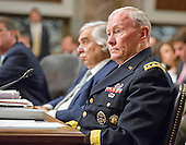 """United States Army General Martin E. Dempsey, the Chairman of the Joint Chiefs of Staff, gives testimony before the United States Senate Committee on Armed Services concerning """"Impacts of the Joint Comprehensive Plan of Action (JCPOA) on U.S. Interests and the Military Balance in the Middle East"""" on Capitol Hill on Wednesday, July 29, 2015.<br /> Credit: Ron Sachs / CNP"""