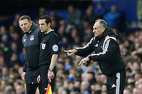 Swansea City Head Coach Francesco Guidolin gestures as he stands in the technical area during the Barclays Premier League match between Everton and Swansea City played at Goodison Park, Liverpool