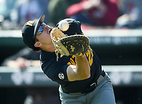 NWA Democrat-Gazette/CHARLIE KAIJO University of Missouri infielder Tony Ortiz (28) makes a catch during a baseball game, Sunday, March 17, 2019 at Baum-Walker Stadium in Fayetteville.