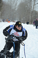 Brent Beck passes by University Lake during the first day of the World Championship Sled Dog Races, a highlight of the 2013 Anchorage, Alaska, Fur Rendezvous.