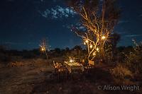 Africa, Botswana, Khwai, The Lodge, Feline Fields, edge of the Kalahari desert. Kalahari bush people, Ju'hoansi tribe. Hunter-gatherer !Kung people, part of San tribe. Evening meal served by The Lodge out in the desert.